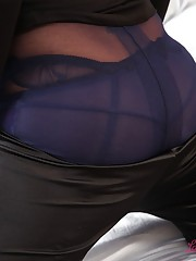 woman in nylons undressing each other